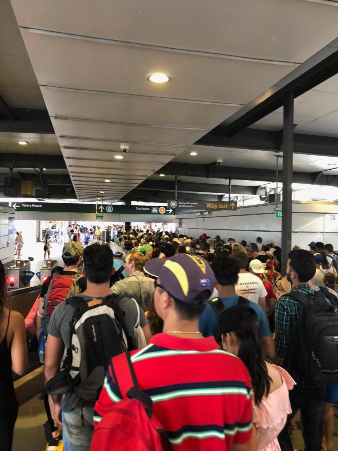 crowds getting off ferry